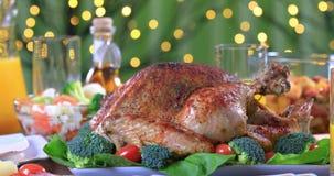 Garnished roasted turkey on festive table closeup stock footage