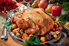 Roasted turkey on holiday table Royalty Free Stock Photos