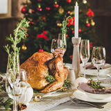 Roasted turkey on holiday table. Close-up view of delicious roasted turkey on holiday table Royalty Free Stock Image