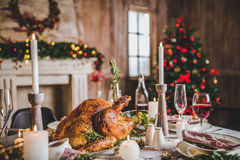 Roasted turkey on holiday table. Delicious roasted turkey on served for Christmas table Stock Photography