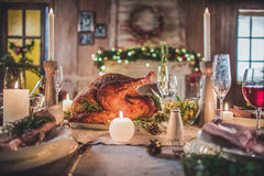 Roasted turkey on holiday table. Delicious roasted turkey on served for Christmas table Royalty Free Stock Photos