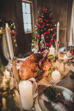 Roasted turkey on holiday table. Delicious roasted turkey on served for Christmas table Royalty Free Stock Image