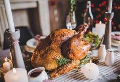 Roasted turkey on holiday table Stock Photos