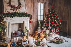 Roasted turkey on holiday table. Delicious roasted turkey on served for Christmas holiday table Stock Photos