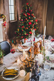 Roasted turkey on holiday table. Delicious roasted turkey and vegetables on served for Christmas table Royalty Free Stock Photo