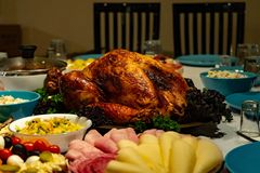Roasted turkey on holiday table stock photo