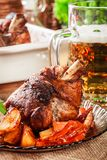 Roasted turkey knuckle with potatoes and vegetable Stock Photography