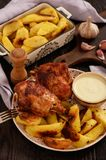 Roasted turkey knuckles with baked potatoes. Roasted turkey knuckles with baked potatoes Royalty Free Stock Image