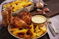 Roasted turkey knuckles with baked potatoes. Roasted turkey knuckles with baked potatoes Stock Image
