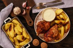 Roasted turkey knuckles with baked potatoes. Roasted turkey knuckles with baked potatoes Royalty Free Stock Photo
