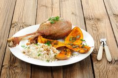 Roasted turkey leg with butternut squash, pumpkin seeds and rice Stock Photography