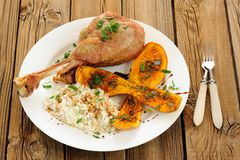 Roasted turkey leg with butternut squash, pumpkin seeds and rice Stock Images