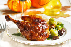 Roasted turkey leg garnished with mash potato, chestnuts andbrussels sprouts Stock Photo