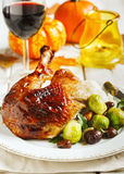 Roasted turkey leg garnished with mash potato, chestnuts and brussels sprouts Stock Images