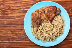 Roasted turkey leg with wild rice Royalty Free Stock Image