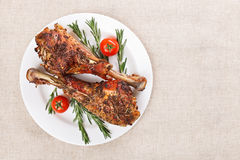 Roasted turkey legs on white plate Royalty Free Stock Photos
