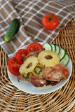 Roasted turkey meat with pineapple and kiwi Stock Photos