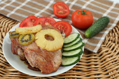 Roasted turkey meat with pineapple and kiwi Royalty Free Stock Photos