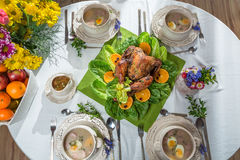 Roasted turkey with oranges served on lettuce served with soup Stock Photo