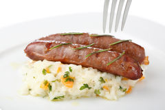 Roasted turkey sausages on a plate isolated Royalty Free Stock Photo