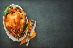 Roasted turkey for Thanksgiving Day or Christmas. Roasted whole turkey for Thanksgiving Day or Christmas on stone table stock image