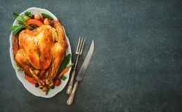 Roasted turkey for Thanksgiving Day or Christmas. Roasted whole turkey for Thanksgiving Day or Christmas on stone table stock photo