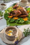 Roasted turkey for Thanksgiving served with soup Royalty Free Stock Images