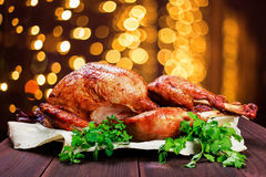 Roasted Turkey. Thanksgiving table served with turkey, decorated with greens and basil on dark wooden background. Homemade food Stock Photography