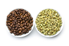 Roasted and unroasted coffee beans Stock Photography