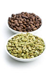 Roasted and unroasted coffee beans Stock Images