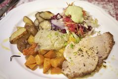 Roasted veal meat with potatoes, jerusalem artichokes. And salad Royalty Free Stock Photography