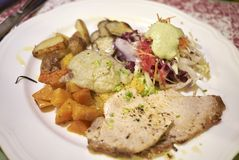 Roasted veal meat with potatoes, jerusalem artichokes. And salad Royalty Free Stock Photo
