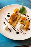 Roasted vegetable pieces, egg, balsamico. Light vegetarian meal appetizer with roasted pieces of celery, vegetable puree, boiled quial egg and balsamico on white stock images