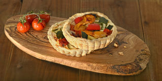 Roasted vegetable quiche and tomato Stock Photos