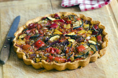 Roasted vegetable tart. With buttery sundried tomato shortcrust pastry royalty free stock photography