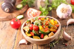 Roasted vegetable and thyme. On wood Stock Photography