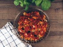 Roasted vegetable on a wooden table. Roasted eggplant, tomatoes and yellow bell pepper in a glass pan on a wooden table Stock Photography