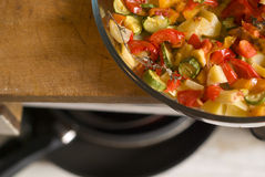 Roasted vegetables. On a wooden plate, depht of field controll on the wood plate Royalty Free Stock Photography