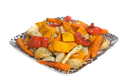 Roasted Vegetables. Oven Roasted Vegetables on china platter isolated over white background Stock Image