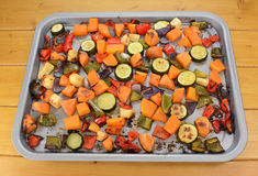 Roasted vegetables on a baking tray Stock Images