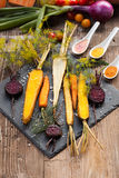 Roasted vegetables on a baking tray. Old dark wooden table, top view Royalty Free Stock Image