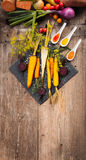 Roasted vegetables on a baking tray. Roasted vegetables (parsnip, red and yellow carrot)on a baking tray, olg dark wooden table Royalty Free Stock Photo