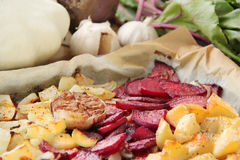 Roasted vegetables. Beetroot, pattypan squash, potatoes, garlic and onion. Fresh vegetables on background. Royalty Free Stock Images