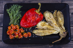 Roasted vegetables in black plate Stock Images