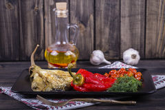 Roasted vegetables in black plate Stock Photos