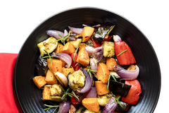 Roasted Vegetables on Black Platter over white Royalty Free Stock Photography
