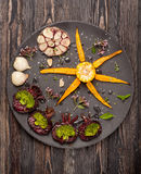 Roasted vegetables: carrots, beets, broccoli, cabbage, garlic Stock Photos
