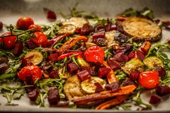 Roasted vegetables with fresh rocket Royalty Free Stock Photo