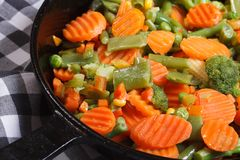 Roasted vegetables in a frying pan macro Stock Photos