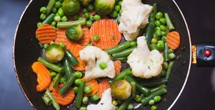 Roasted vegetables in a frying pan, a vegetable stew on top,. Concept of healthy nutrition royalty free stock images